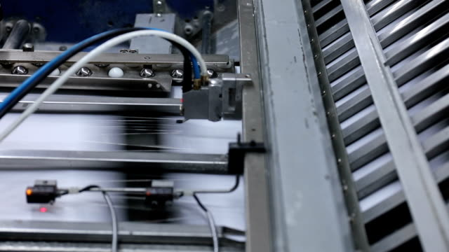 folding machine folds printed offset sheet - folded paper stock videos and b-roll footage