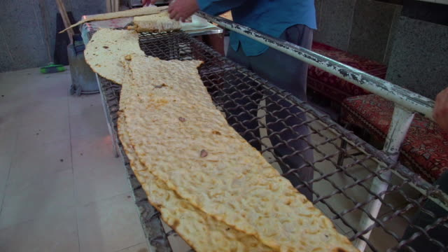 folding naan on cooling rack - iran stock videos & royalty-free footage