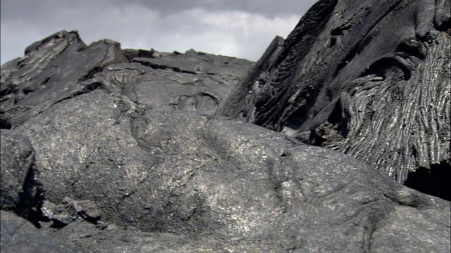 folds in a lava field create surreal formations. - folded stock videos & royalty-free footage