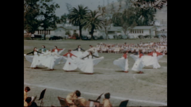 1947 folk dances, beauty pageants and festivals all take place in the parks of los angeles - anno 1947 video stock e b–roll