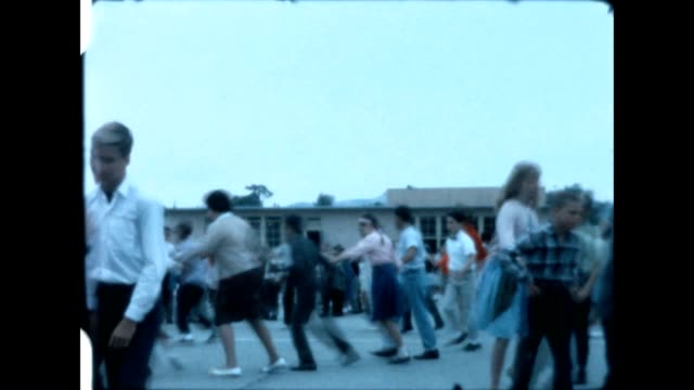 vídeos de stock e filmes b-roll de folk dancing at the fair avenue elementary school in the san fernando valley in the 1960's. - jeans