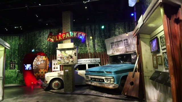 Folk Park exhibit at the Abba Museum in Stockholm Sweden on October 7 Wide shots and pans of the Folk Park exhibit Wide shot of two GMC trucks and a...
