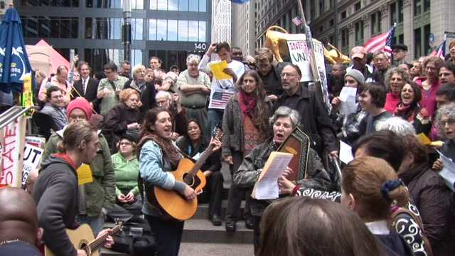 """folk singers perform protest songs at zuccotti park / songs performed are """"oh, beautiful,"""" """"like a rolling stone,"""" and """"this land is your land""""... - occupy protests stock videos & royalty-free footage"""