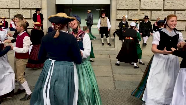 vídeos de stock, filmes e b-roll de folklore groups from schleswigholstein stand outside the reichstag before celebrations to mark german unity day scheduled for wednesday on october 1... - tradição