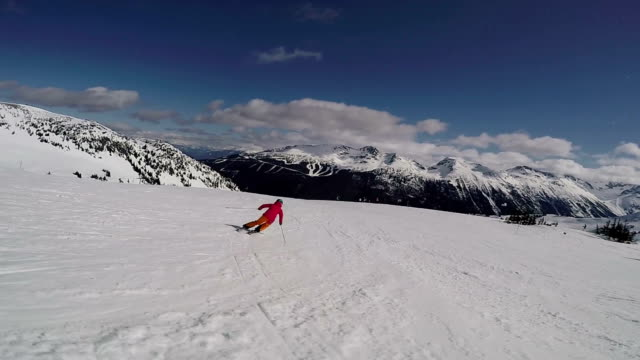 Follow cam footage of a skier