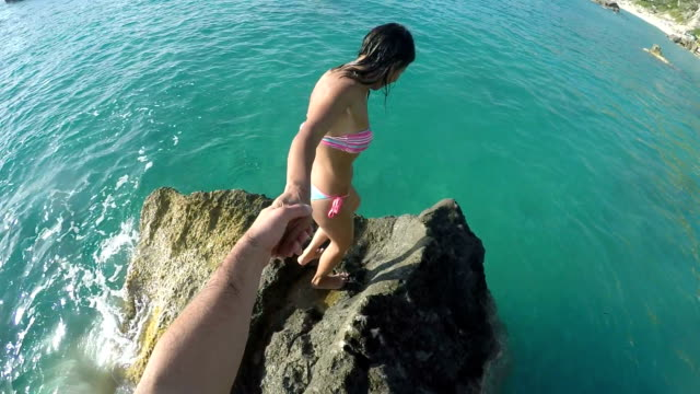 follow me into the sea - jumping stock videos & royalty-free footage