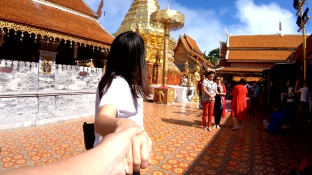 follow me to temple - holding hands stock videos & royalty-free footage
