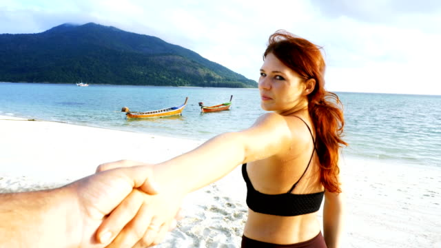 follow me to the beach. redhead girl taking her partner to lagoon - thailand stock videos & royalty-free footage