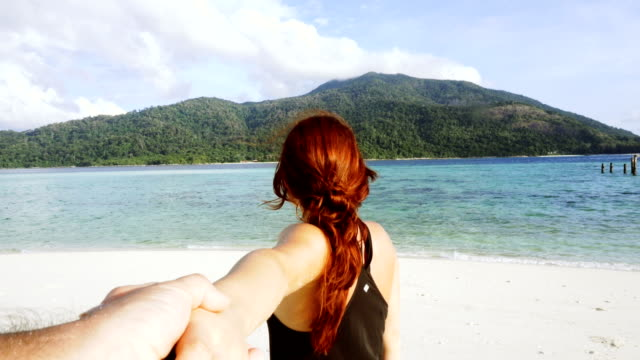 follow me to the beach. redhead girl taking her partner to lagoon - dating stock videos & royalty-free footage