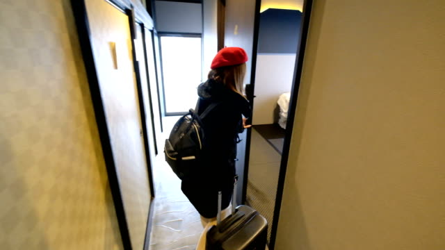 4K Follow Shot : Female tourists stay on Ryokan traditional hotel room. A tourists arriving and checking in.