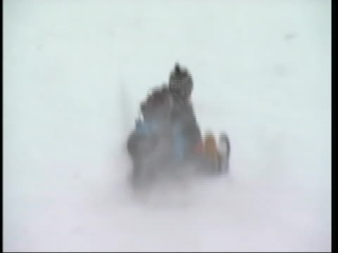 follow shot of 3 kids being pushed down the hill on a sled by another person this shot was taken on christmas day 2010 in chicago many gathered in a... - warm clothing stock videos & royalty-free footage