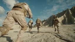 Follow Shot of Squad of Soldiers Running Forward During Military Operation in the Desert.