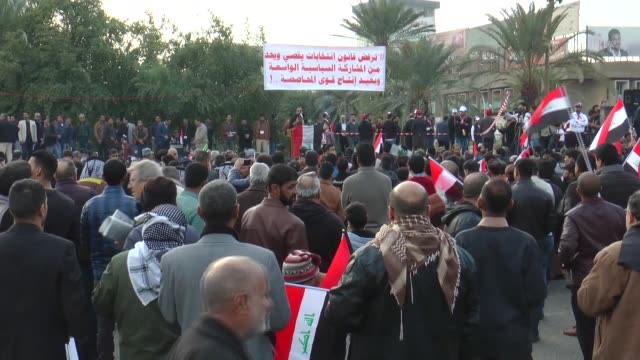 followers of shiite cleric muqtada alsadr protest iraqi government and corruption at tahrir square in baghdad iraq on january 20 2017 - muqtada al sadr stock videos & royalty-free footage