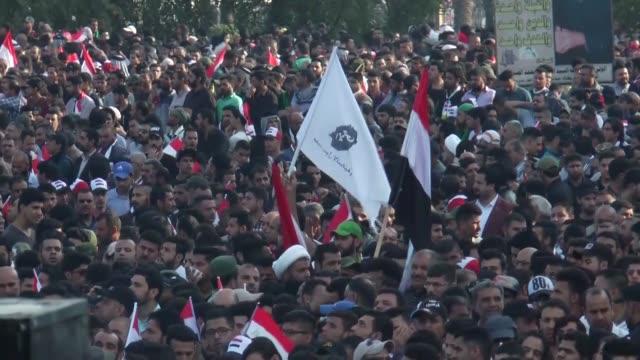 followers of the iraqi shia cleric and politician muqtada alsadr held a huge protest at tahrir square in baghdad iraq on march 24 2017 muqtada alsadr... - muqtada al sadr video stock e b–roll