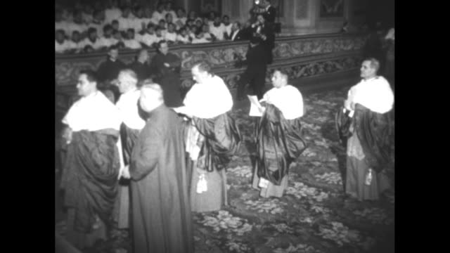 ms following a ceremony to ordain 24 new cardinals pope pius xii is carried on gestatorial chair on past audience down aisle in st peter's basilica /... - swiss guard stock videos and b-roll footage