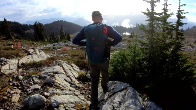 following a hiker in the mountains - extreme terrain stock videos & royalty-free footage