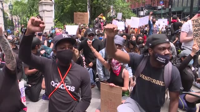 following a night of often violent protests, demonstrations continue in manhattan against the police killing of george floyd on june 02, 2020 in new... - violence stock videos & royalty-free footage