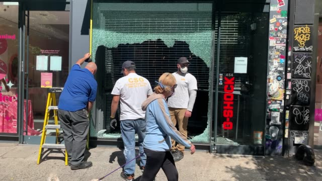 following a night of protests, broken windows and looted stores stand in manhattan's exclusive soho neighborhood on june 01, 2020 in new york city.... - looting stock videos & royalty-free footage