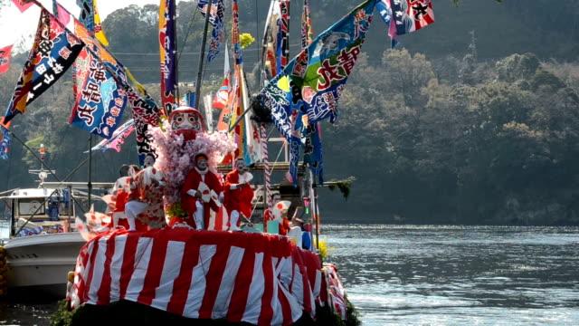 following a spring tradition, fishermen in the osezaki district of numazu, shizuoka prefecture, powdered their faces white and put on women's clothes... - white点の映像素材/bロール