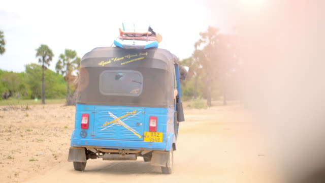 following a tuktuk by motorbike to the beach - rickshaw stock videos and b-roll footage