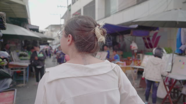 following a woman walk through an asian marketplace - following stock videos & royalty-free footage