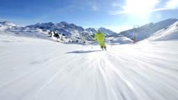 following alpine skier