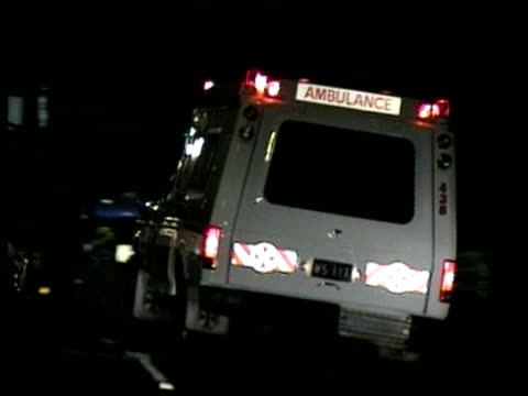 POV following ambulance at night