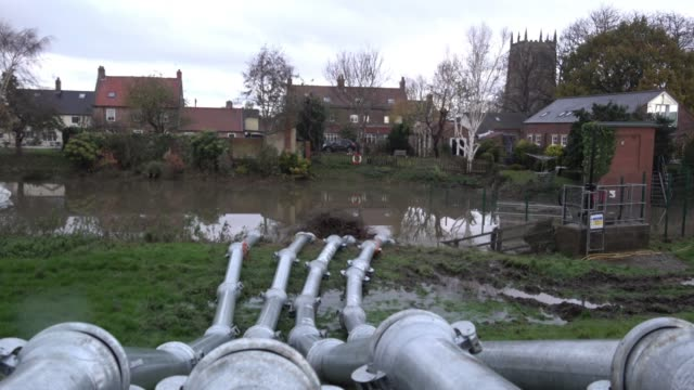 following another night of intense rainfall residents of the south yorkshire village worst hit by flooding return to assess the damage in their homes... - yorkshire england stock videos & royalty-free footage