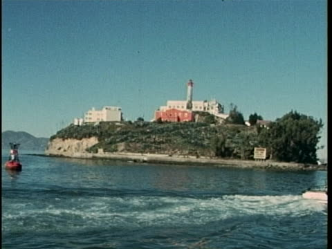 pov following boat and approaching shore of alcatraz island - san francisco bay stock videos & royalty-free footage