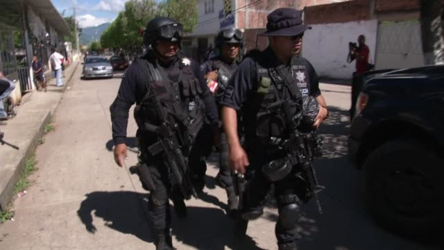 following deadly attacks by armed men on security forces the mexican police and army have gone to war against the knights templar a powerful drug... - michoacán video stock e b–roll