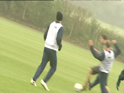 Following Dennis Bergkamp running and tackling during bounce match Arsenal FC training session London Colney 18 May 04