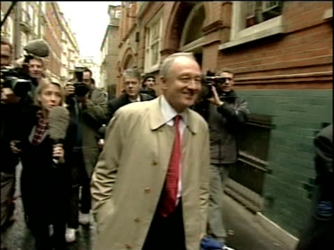 stockvideo's en b-roll-footage met following four year expulsion mayor of london ken livingstone walks down street laughing surrounded by press following his re admission into labour... - ken livingstone