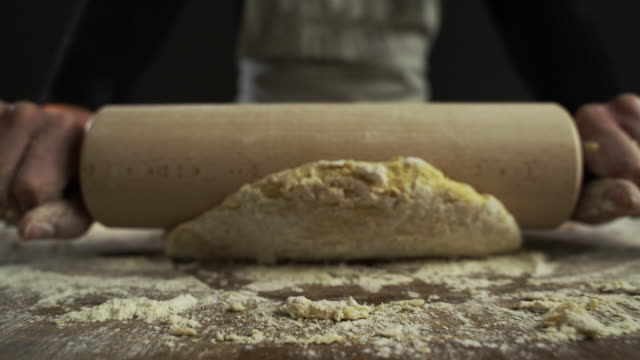 following motion of rolling pin rolling out dough - rolling pin stock videos & royalty-free footage