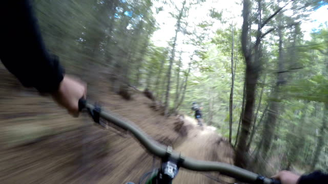 POV following mountain biker down technical trails