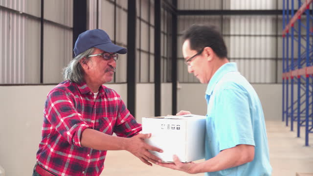following on body of warehouse senior asian worker received delivering, shipping many cardboard boxes from a car with a postal worker with feeling positive emotions and happiness that sends packages from shopping online to a distribution warehouse. - stacking stock videos & royalty-free footage