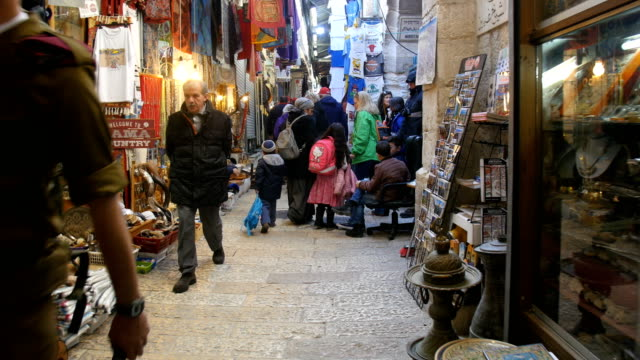 following people walking in old city alleys/ jerusalem old city - jerusalem old city stock videos and b-roll footage