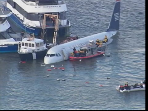 """following pilot of us airways flight 1549, chesley """"sully"""" sullenberger landing in the hudson river, passengers and crew are shown on plane and on... - river hudson stock videos & royalty-free footage"""