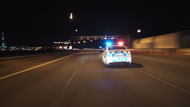 t/l pov following police car on motorway, auckland, new zealand - car point of view stock videos & royalty-free footage