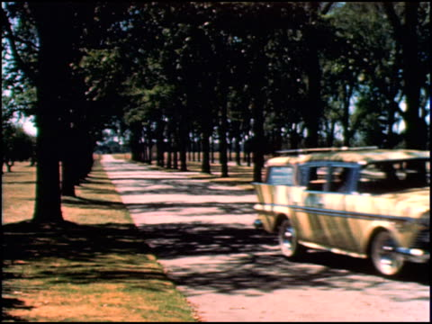 vídeos de stock e filmes b-roll de shot following rambler station wagon riding on country road / ws front of rambler drives toward camera turns out of frame / ws rear of rambler pulls... - baixar