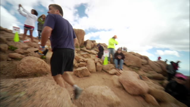 WS TS Following runner from behind finishing in race / Colorado Springs/ Pikes Peak, CO, USA