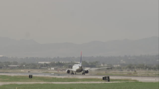 Following shot of an airplane taking off at the Salt Lake Airport.