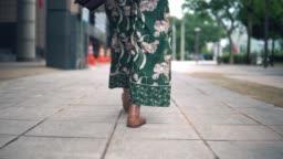 Following shot of beautiful asian girl walking outdoor