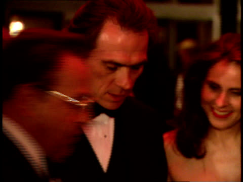 stockvideo's en b-roll-footage met following shot of tommy lee jones walking down the red carpet at swifty lazar's oscar party. - oscar party