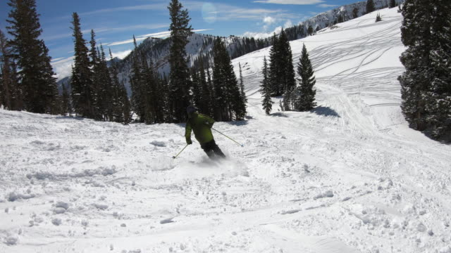 following skier in mountains on clear blue day - utah stock videos & royalty-free footage