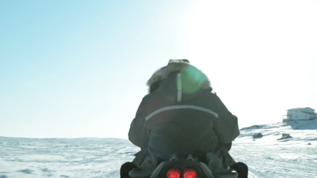 following snowmobile in arctic - nu stock videos & royalty-free footage