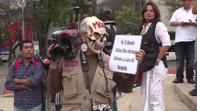 following the murder of a third journalist in just one month more than a hundred people gather in mexico city to protest for the rights of... - killing stock videos & royalty-free footage