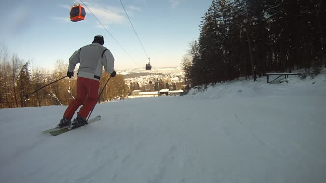 hd: following the skier along ski slope - downhill skiing stock videos & royalty-free footage
