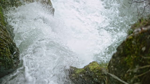 slo mo following the water running down the waterfall - water video stock e b–roll
