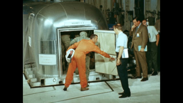 following their splashdown on earth, the apollo 11 astronauts disembark from the uss hornet and enter the mobile quarantine facility. - splashdown stock videos & royalty-free footage