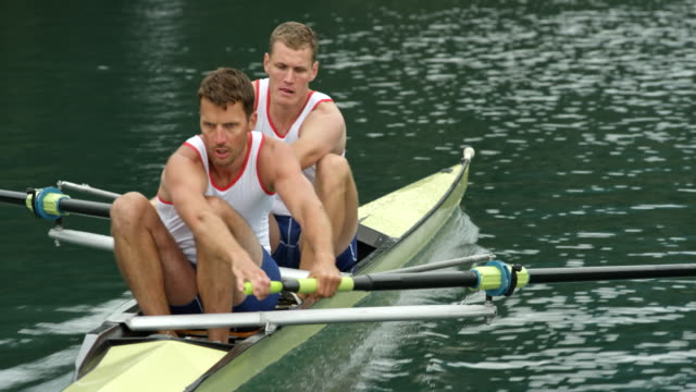 following two male athletes rowing in a coxless pair - scull stock videos & royalty-free footage